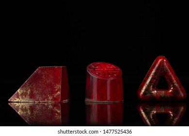 Red exclusive chocolate bonbons on black