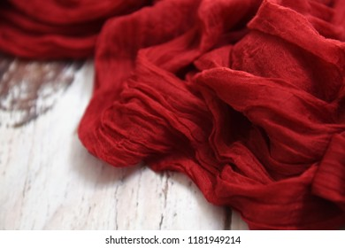 Red fabric on a white table