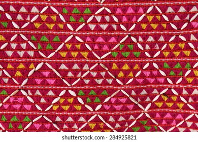 red fabric pattern background ,geometric shapes. Colorful mosaic pattern. Retro triangle background, handcraft