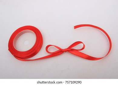 red fabric ribbon with bow