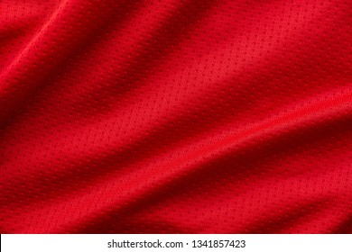 Red fabric sport clothing football jersey with air mesh texture background