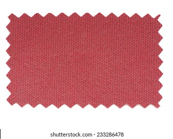 Red fabric swatch cut with pinking shears zig zag scissors