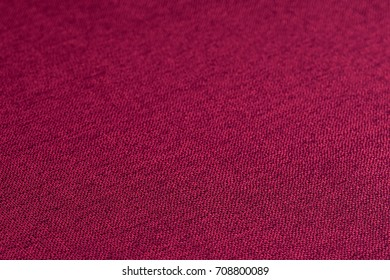 Red fabric texture. Abstract background, empty template. Selective focus.