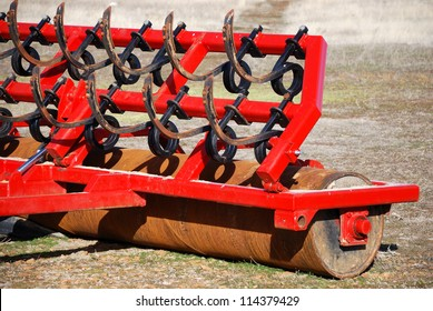 Red farm tool used to remove and flatten the farmland