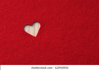 Red felt with heart. Background Valentine's Day