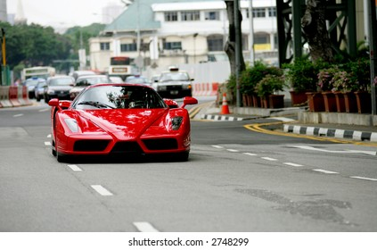 Red Ferrari Enzo on the road in Singapore