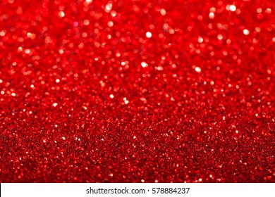 Red festive background with sparkles in the bokeh. The concept of the celebration, the day of St. Valentine, New Year, birthdays, ceremonies, events, etc.