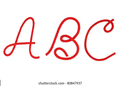 Red fiber rope bent in the form of letter A,B,C