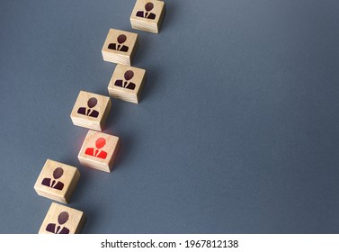 Red figurine of a businessman in a chain of people. Violation of the integrity of the system, non-conformist. Burnout at work, physical and psychological exhaustion. Incompetent unreliable employee