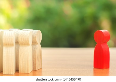 red figurine of a man stands aside from the crowd of people. Asociality, sociopathy. Rejected from society, lonely. Development of leadership and social qualities. Infected, fear and misunderstanding.