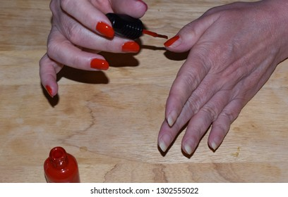 Red Fingernail Polish Application