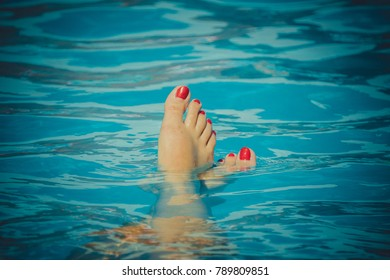 red fingernails in the water