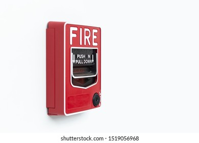 Red fire alarm box on white wall Inside building, Alarm device.