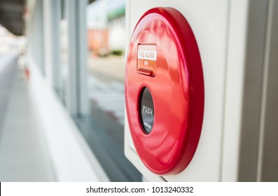 Red fire alarm mounted on the wall on jan, 27,2018 in phathumtani Thailand