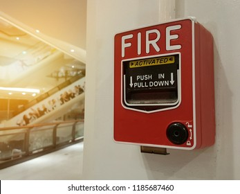 Red Fire alarm on white wall Emergency concept.