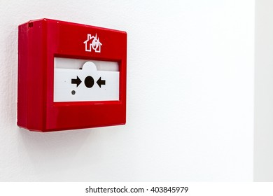 Red fire alarm panel box is on the wall, to smash glass and press button. Every building is required to have a fire alarm.