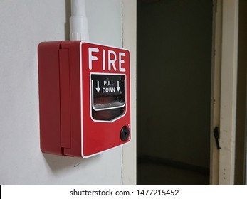 red fire alarm pull station on the wall