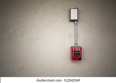 Red fire alarm switch on wall