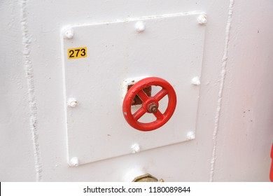 red fire damper valve on a cruise ship