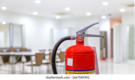 Red fire extinguishers available in fire emergencies,safety concept.