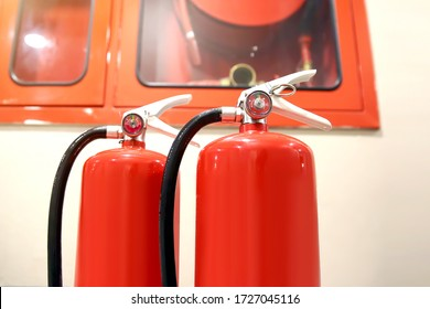 Red fire extinguishers tank in the fire control room for safety and fire prevention.