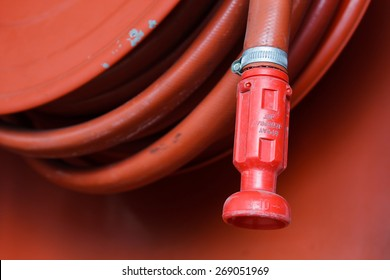 Red fire hose in the reel