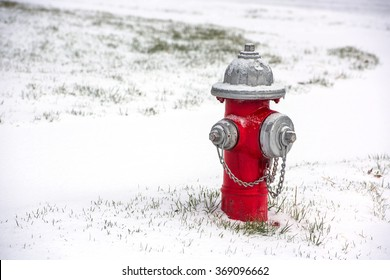 A red fire hydrant buried in snow