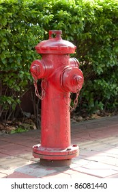 """Red fire hydrant with Chinese letters """"fire hydrant"""""""
