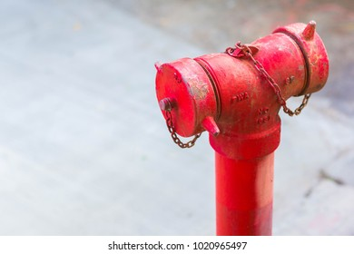Red fire hydrant with defocused concrete floor for copy space.