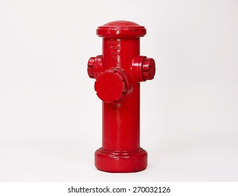 Red Fire Hydrant isolated on White Background. Front View of a Classic Street Hydrant with Text Space