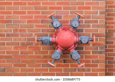 Red Fire Hydrant on a brick wall