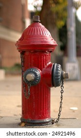 A red fire hydrant on a city street.