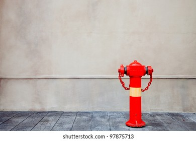Red fire hydrant over the wall