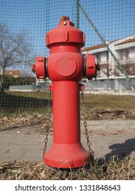 a red fire hydrant in the street