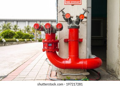 Red fire hydrant in Thailand.
