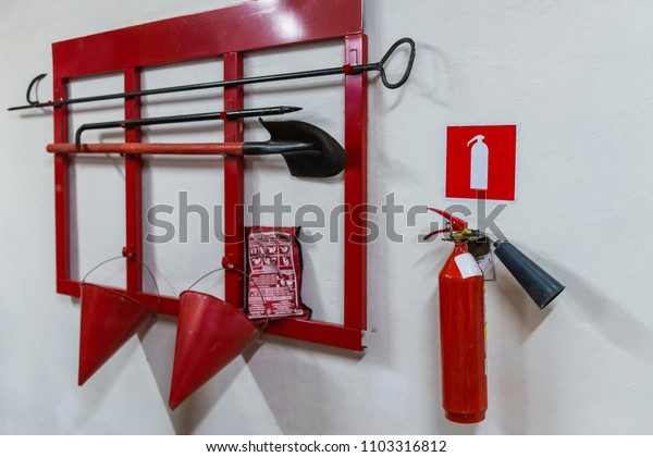 Red fire stand with fire extinguishing tools