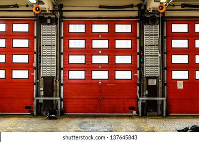 Red Fire Station doors closed at a fire station in England, UK