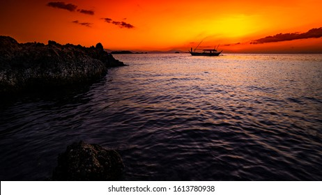 Red fire sunset with a fishing boat in the Philippines.