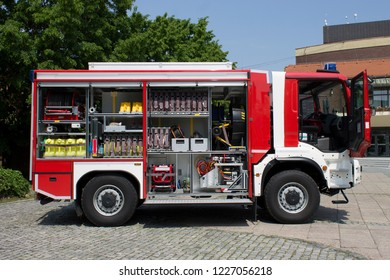 Red fire truck with open door and all his equpment on hot summer day|Cakovec