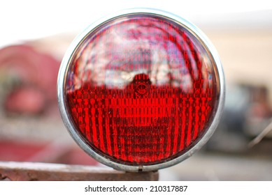 Red Fire truck tail light against a blurry background of Fleet Vehicles
