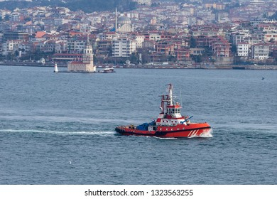 Red fire tug boat equipped with saftey equipment