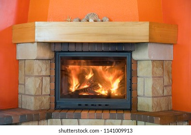 red fireplace with a small hell inside