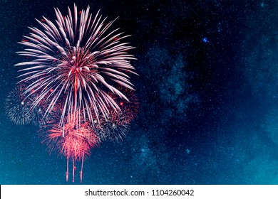 Red Fireworks with blur milky way background