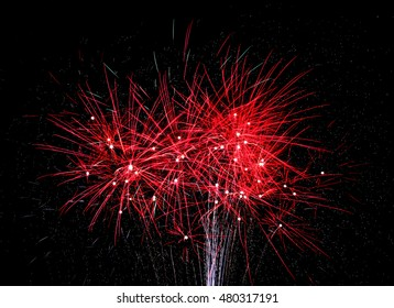 Red fireworks light the night on the 4th of July 2015