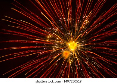 Red fireworks in the night sky. Red background
