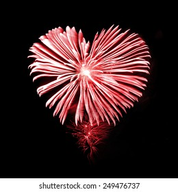 Red fireworks in the shape of a heart