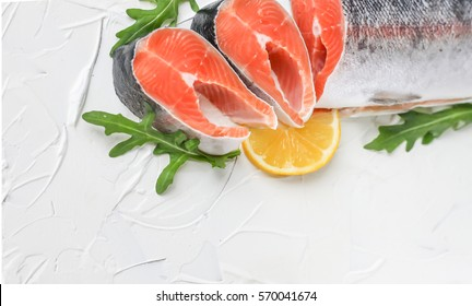 Red fish - salmon with arugula and lemon