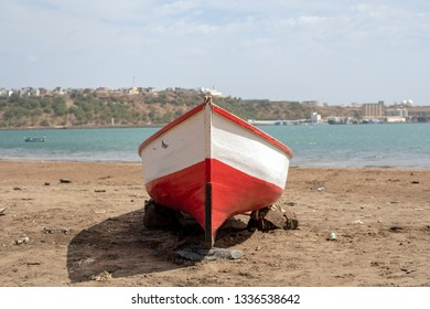 Red fisherman boat on the city beach of Praia, Santiago island, Cape Verde, Cabo Verde.
