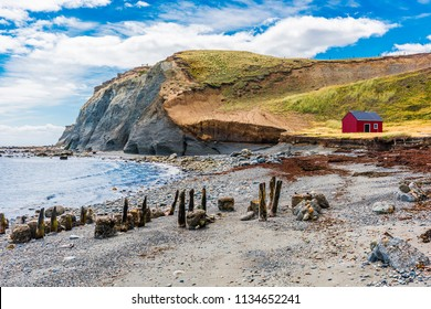 Red fisherman's cottage near the coast in the small village Cameron. Tierra del Fuego, Chile