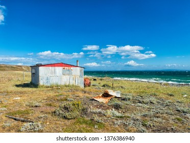 Red fisherman's cottage near the coast. Tierra del Fuego, Chile
